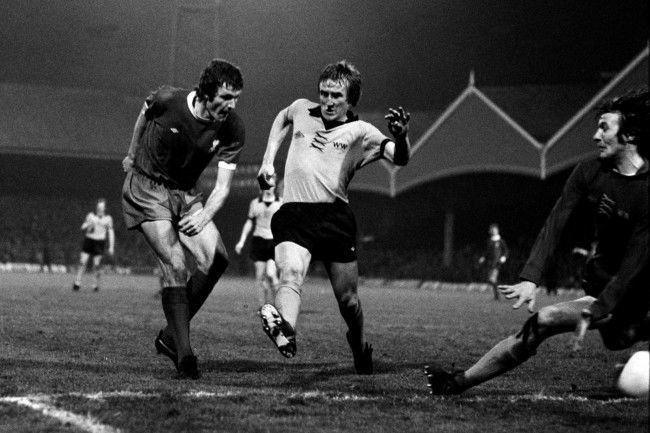 Liverpool's John Toshack (l) fires the ball past Wolverhampton Wanderers' Derek Parkin (c) to score his team's second goal in the 3-1 win