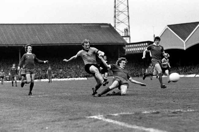 Wolverhampton Wanderers' Steve Kindon (second l) fires in the opening goal, with Liverpool's (l-r) Phil Neal, Phil Thompson and Emlyn Hughes unable to stop him