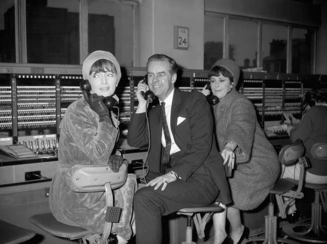 (L-R) Jan Holder, Ian Carmichael and Dilys Laye at the switchboard of the Shoreditch telephone exchange to celebrate the 150th performance of Keith Waterhouse's and Willis Hall's telephone comedy 'Say Who You Are' in which the three are stars Date: 24/02/1966