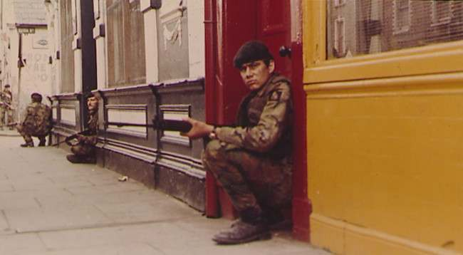 BELFAST IRA CLASHES - British troops take up positions in the doorways of shops near Eliza street, in the markets area of Belfast, a short distance from the city centre of Northern Irelands capital. Area was the scene of continued bitter fighting as British forces clashed with elements of the Irish Republican Army provisional wing. (AP-Photo/Peter Kemp) 08/17/1971