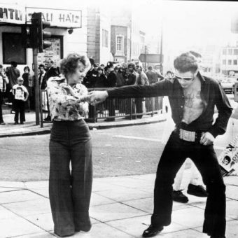 Elvis Presley Fans Dance On A Traffic Island Outside The Palais De Danse Hall in Nottingham