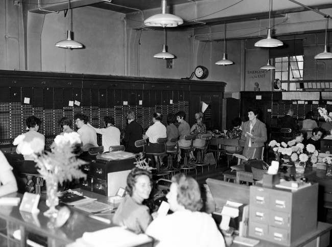 A general view showing the inside of the old exchange which will cease to operate. The telephonists at present employed in the old exchange have been found employment in the East Telephone Areas. Date: 08/09/1965