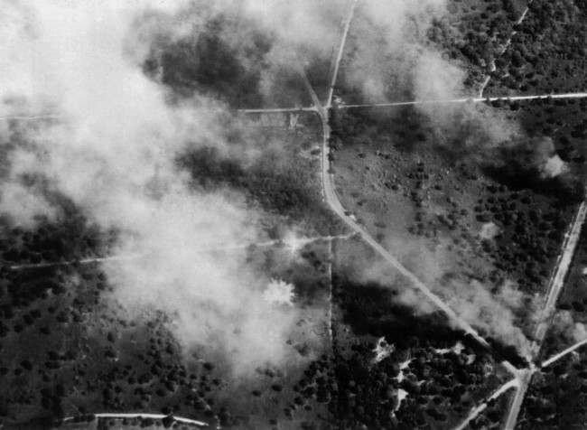 As Von Kluge's Army in Normandy tries desperately to escape from the advancing Allied forces and now openly uses the roads by day, every aircraft that 2nd R.A.F. can put into the air is hammering away at the retreating columns. Many of the German transports were jammed bumper to bumper and a great toll was taken by R.A.F. Spitfires, Typhoons and Mustangs. Wrecked enemy vehicles burning of one of the roads after attacks by aircraft of 2nd R.A.F. in Normandy, France in 1944 (AP Photo)