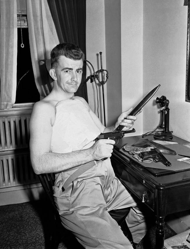 Associated Press war correspondent J. Wes Gallagher arrived in New York by plane on June 6, 1943, from the North African front with two reminders of the war, a cast around his body and a souvenir collection of axis guns. Gallagher suffered a compression-type spine fracture in a jeep accident near Bizerte. (AP Photo)