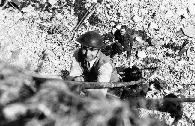 J. Wes Gallagher, Associated Press war correspondent in London, takes lessons in the Tommy-gun with the Canadian Army's Commando School, June 10, 1942. This is in sharp contrast to his usual beat of covering activities of the U.S. Embassy in London. (AP Photo)