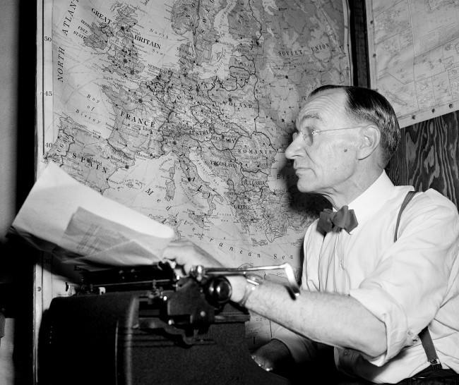Kirk Simpson, Associated Press war analyst and Pulitzer Prize winner, retires to his typewriter and his maps to study the day's war dispatches and report for Associated Press member newspapers, Sept. 2, 1943. (AP Photo) Ref #: PA.11663933  Date: 02/09/1943