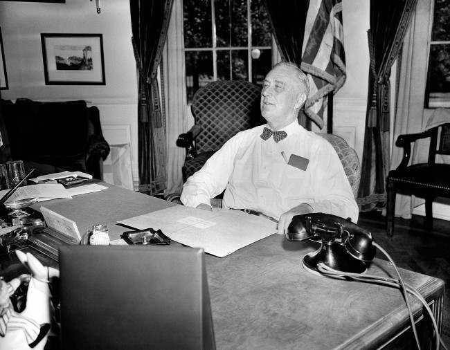 U.S. President Franklin D. Roosevelt wears an expression of confidence and determination as he receives visitors in his White House office on this long-awaited D-Day of the start of the western European invasion in Washington on June 6, 1944. (AP Photo)