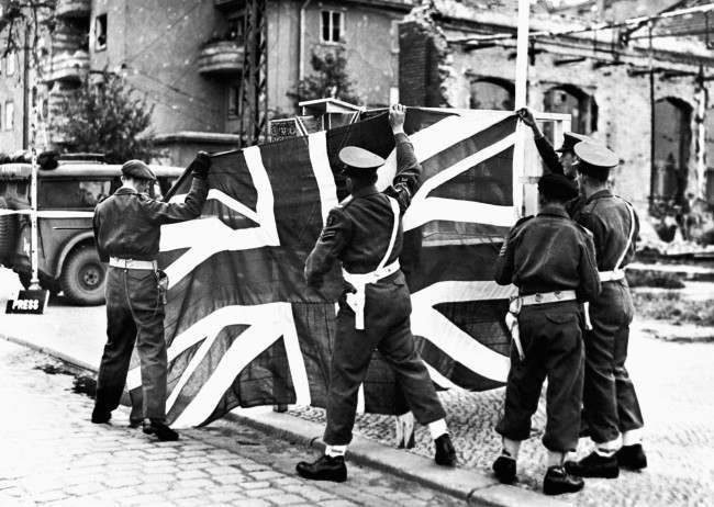 An historic occasion as British Military Policemen prepare to hoist the Union Jack to receive the official entry of the British Army into Berlin. Part of the PA World War Two Collection. Ref #: PA.1236999  Date: 30/05/1945