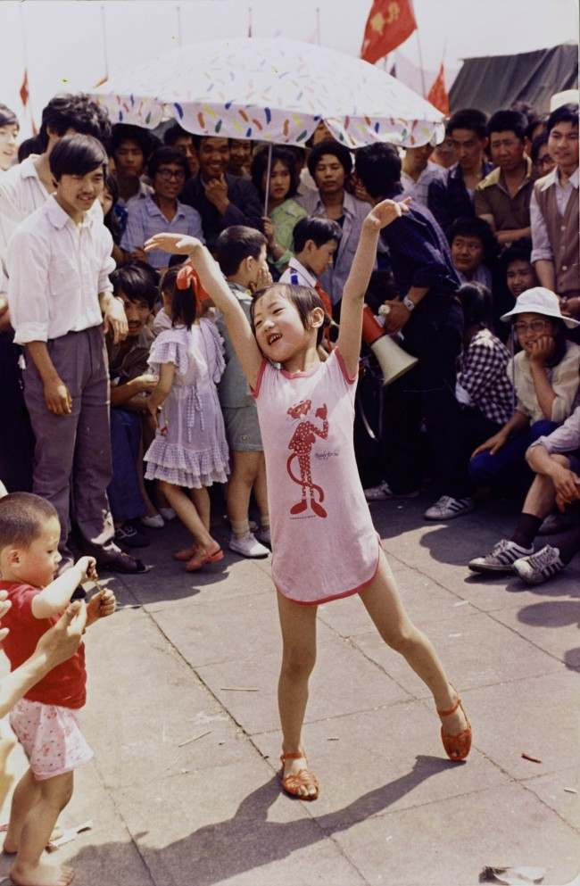 A young Chinese girl dances on Tiananmen Square about June 1, 1989, as pro-democracy protesters continued to occupy the square. Hundreds were killed a few days later in violent clashes between the demonstrators and government troops. (AP Photo/Jeff Widener) Ref #: PA.19962918  Date: 01/06/1989