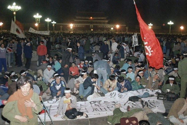 "About 3,500 university students from more then a dozen school demand democracy and freedom keep on hunger strike at night, Saturday, May 14, 1989 in Beijing at Tiananmen Square. Students said they would end the hunger strike only when the government agrees to ""equal and sincere"" talks to their demands. (AP Photo/Sadayuki Miakmi)"