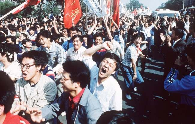 Chinese students shout after breaking through a police blockade during a pro-democracy march to Tiananmen Square, Bejing, May 4 1989. (AP Photo/S. Mikami)
