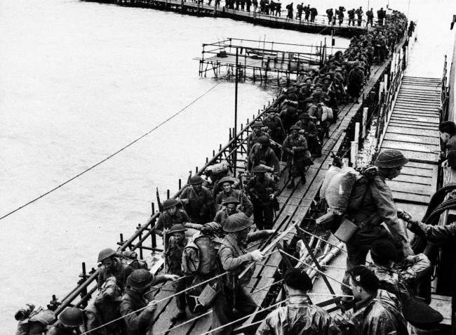 British reinforcement troops from the Royal Pioneers Corps and Royal Engineers embark LCI at an English port, underway to join the Allied invasion in Normandy, France, in June 1944. (AP Photo)