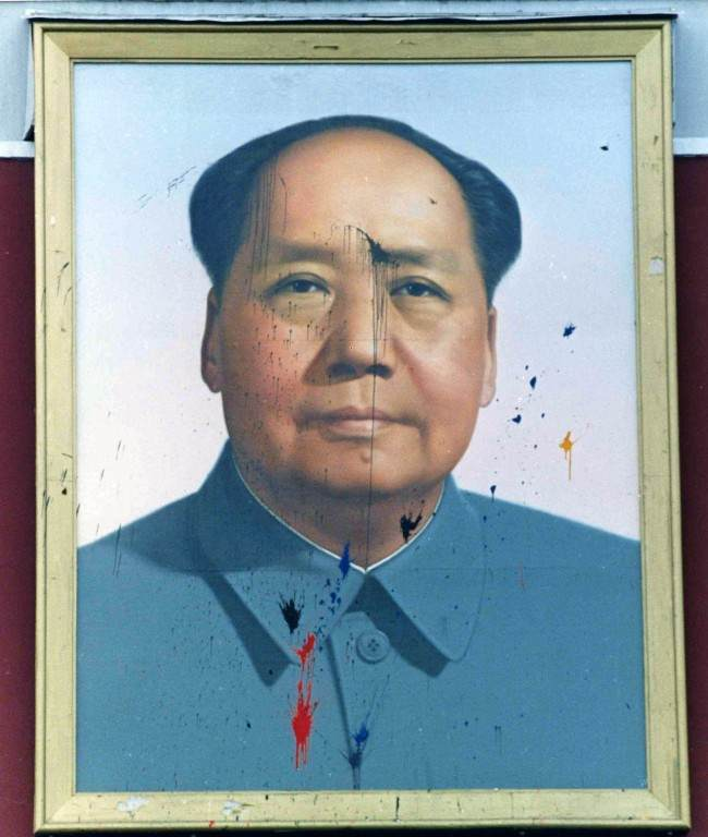 The famous portrait of Chairman Mao looking out over Tiananmen Square, Beijing, from the Forbidden City, May 23, 1989, was spattered with paint during the continuing demonstration in the square. (AP Photo/Avery)