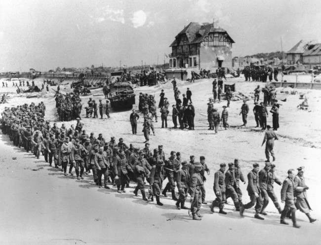 German prisoners of war, captured during the Allied Normandy invasion, are marched to the ships that bring them into captivity in England, in June 1944, at Bernieres-sur-mer, France. (AP Photo)