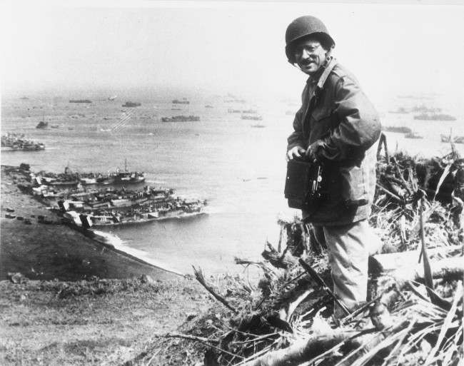 Joe Rosenthal, Associated Press photographer, is shown with his camera equipment looking over Iwo Jima, Japanese volcano island, in March 1945 during World War II. (AP Photo/U.S. Marine Corps) Ref #: PA.8695719