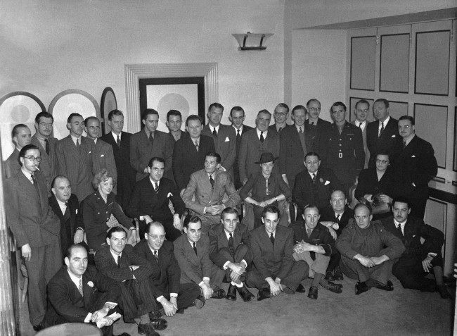 Mr. Lloyd Stratton, assistant general manager of the Associated Press and president of the Associated Press of Great Britain, Ltd., hosted a luncheon in the Savoy Hotel for AP staffers, Oct. 24, 1943. Seated in front row, from left to right are: A.I. Goldberg, H.W. Tetlow, Henry B. Jameson, E.D. Ball, W.W. Hercher, E.C. Daniel, E.S. Worth, R.G. Massock, H.J.R. Winter, Fabio Ziffer. Second row, from left to right, are: M. Rosenbaum, Reginald Williams, Ruth Cowan, R. E. Bunnelle, London bureau chief, Lloyd Stratton, Jean O'Donnel, J.J. Wurzel, secretary of the Associated Press of Great Britain Ltd., and Barbara Wace. Back row, left to right, are: R.N. Sturdevant, Gladwin A. Hill, Tom Halfpenny, E. Blake Sullivan, Pugh Moore, George Bede Irvin, Leo Branham, Russell Landstrom, John F. Chester, Judson O'Quinn, W. Franklin, K.C. Boxall, Jack Smyth, N.J. Badderly, W.S. White, H.W. Bagley, Roger D. Greene, and L.E. Hawkins. (AP Photo) Ref #: PA.9470037  Date: 24/10/1943