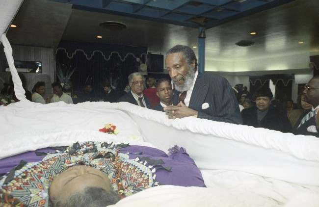 Nutrition guru Dick Gregory, right, pays his respects at the funeral of Walter Hudson, who weighed over 1,000 pounds when he died Christmas Eve in Hempstead, New York, Jan. 2, 1992. Hudson had at one point lost more than 600 pounds with the help of Gregory. (AP Photo/Mike Albans)