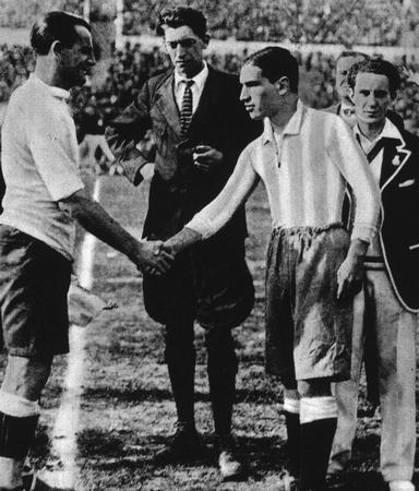 World Cup Final 1930 Montevideo, Uruguay, Uruguay 4 v Argentina 2. Belgian referee John Langenus looks on as Uruguay's captain Jose Nasazzi shakes hands with Argentina's Manuel Ferreira.