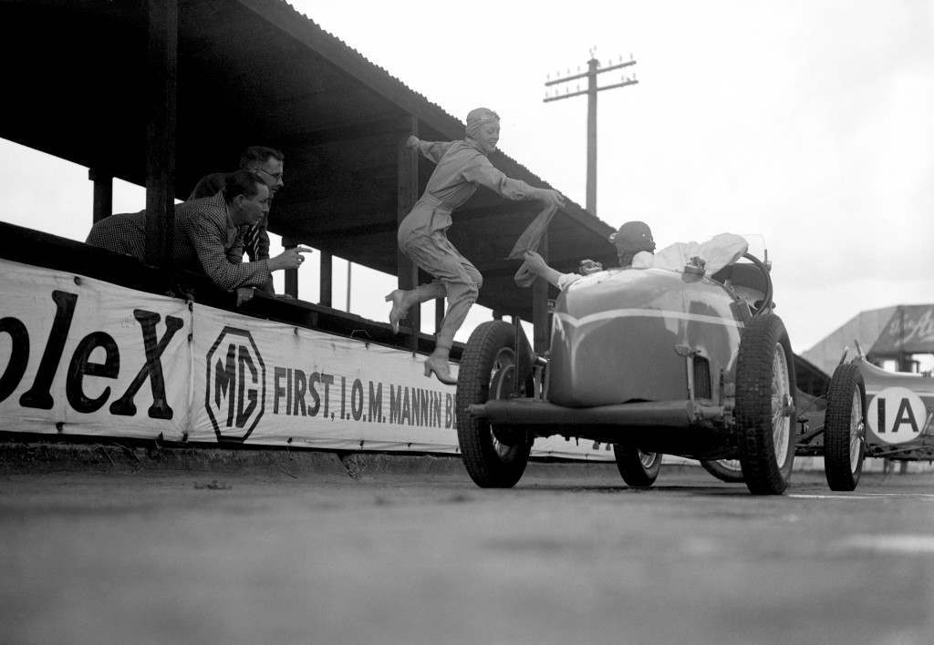Doreen Evans taking over the sash during a relay race at Brooklands, July 1935.