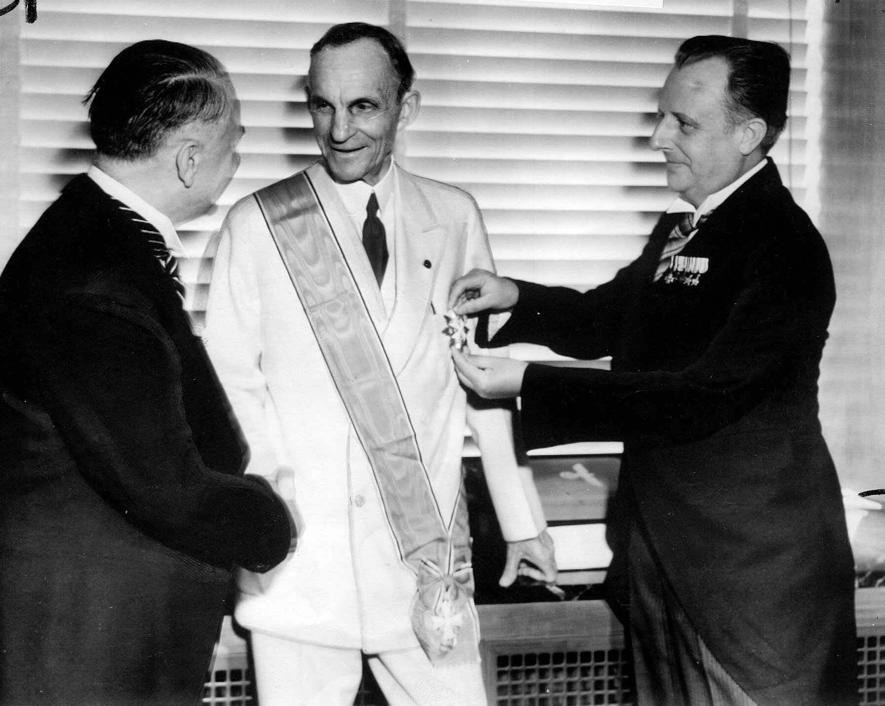 German diplomats award Henry Ford, center, Nazi Germany's highest decoration for foreigners, The Grand Cross of the German Eagle, in Detroit for his service to the Third Reich.
