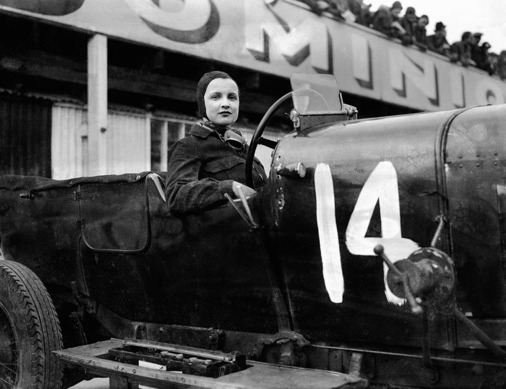 "Kay Petre at Brooklands. Only 4'10"" tall she's seated in her huge 10.5 litre V12 Delage."