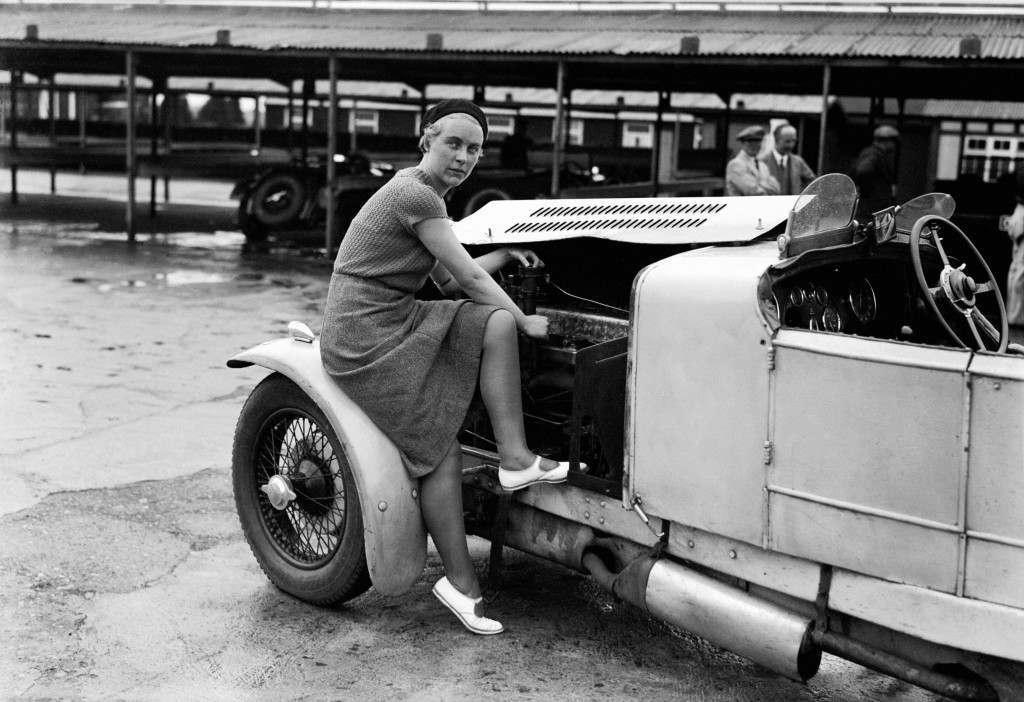 Kitty Brunell tunes up her AC Ace Sports engine, 1932. Kitty was known as a rally driver and would be the only woman ever to win the British RAC Rally, in 1933. She never raced competitively at any track, but did use Brooklands for tuning and circuit testing her car.