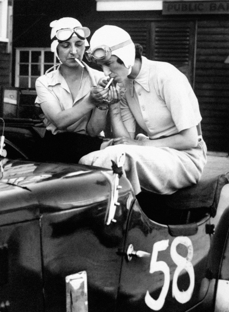 Mrs Gordon Simpson and the young racing driver Joan Richmond sitting in the latter's 1921 3-litre GP Ballot racer, July 1934.