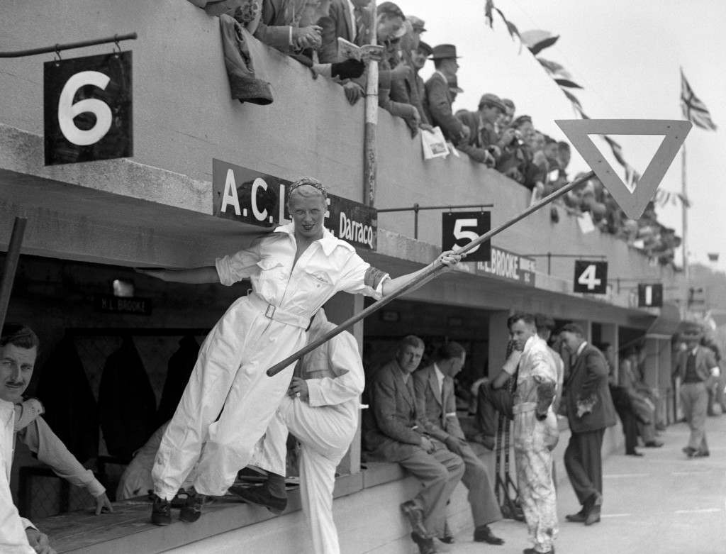 Mrs Aclace signals from the pits during the JCC 200 mile race at Brooklands, August 1938.