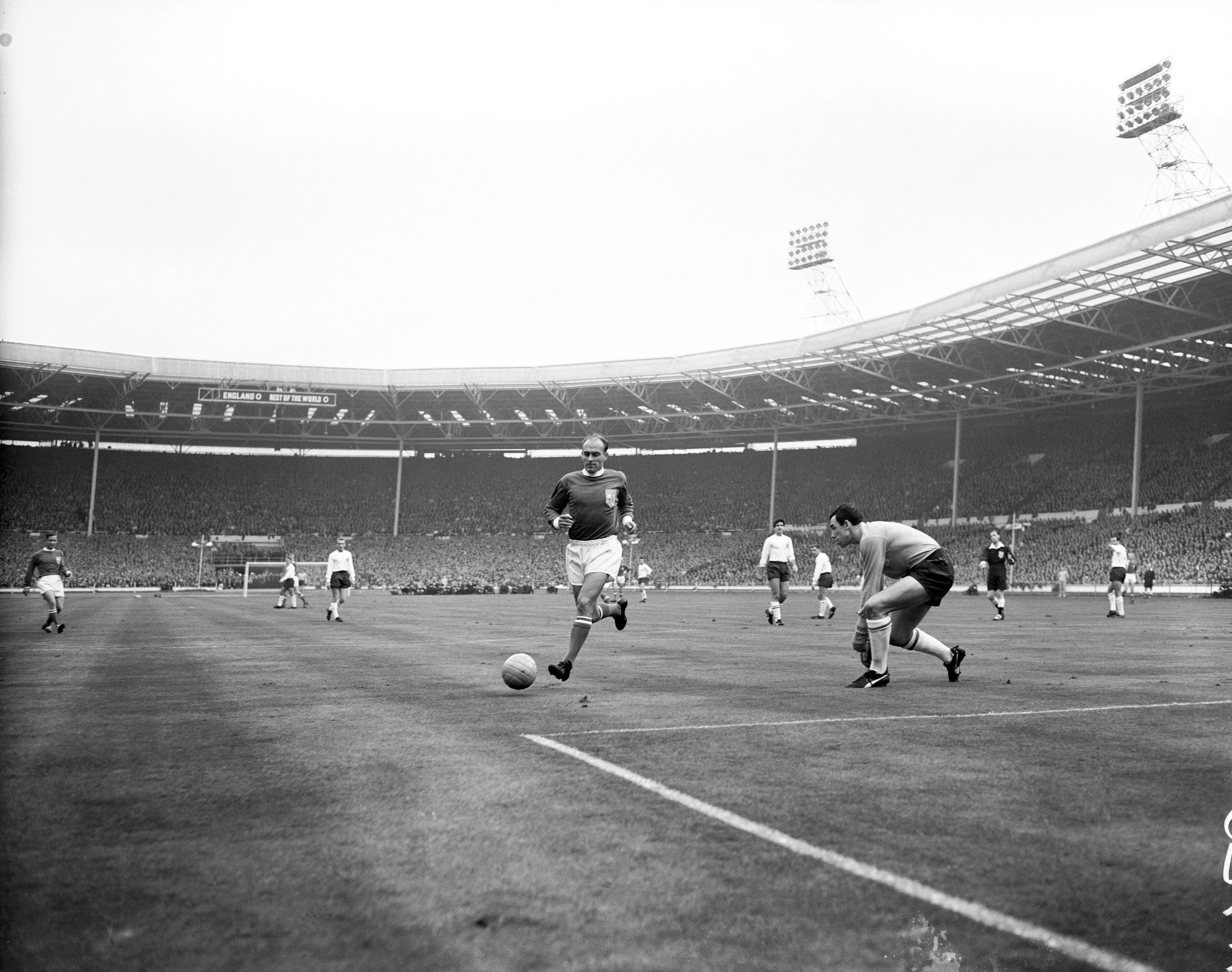 Soccer - FA 100th Anniversary Match - England v Rest of the World Rest of the World's Alfredo di Stefano (l) chases a through ball as England goalkeeper Gordon Banks (r) comes out to meet him  Date: 23/10/1963