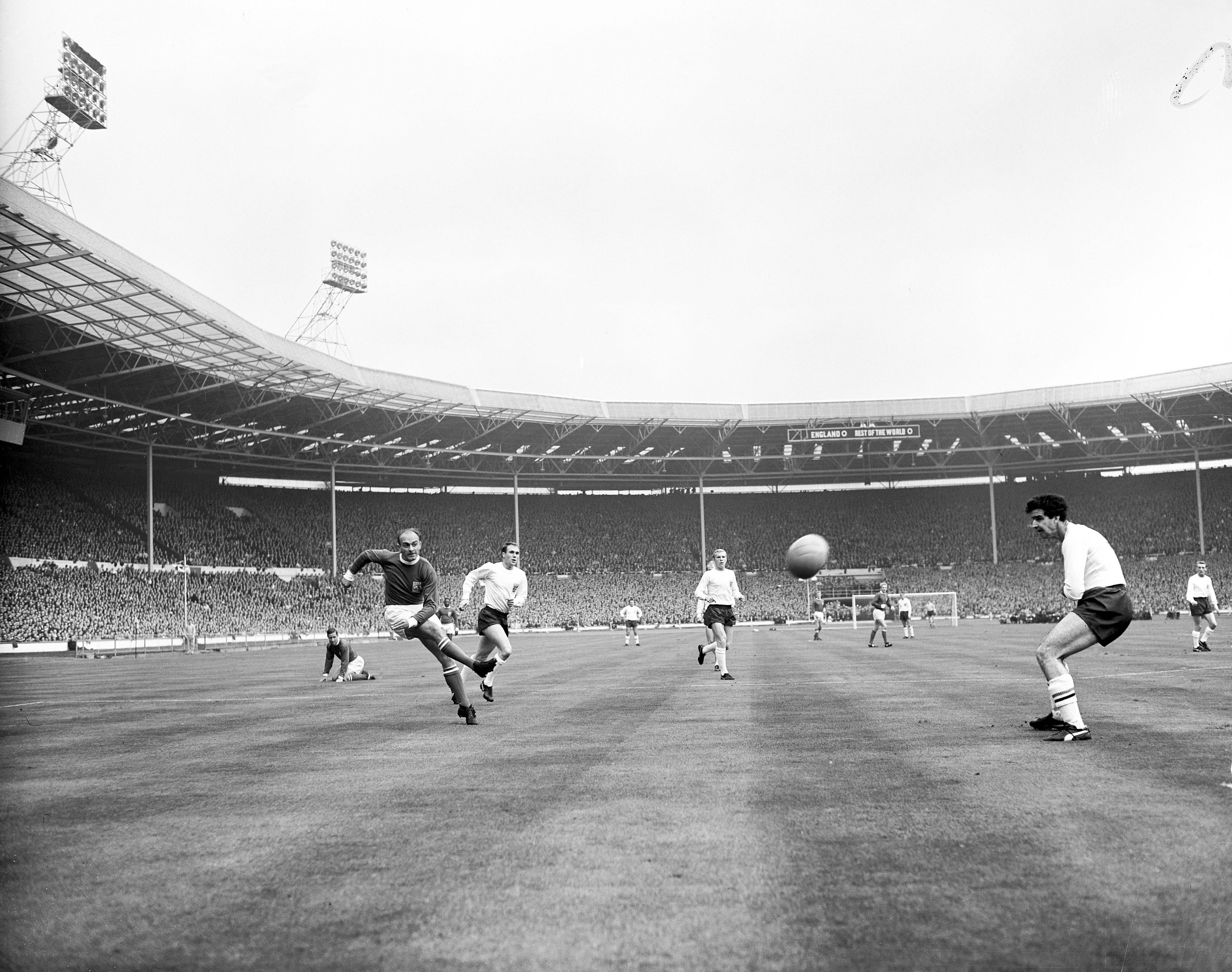 Soccer - FA 100th Anniversary Match - England v Rest of the World Rest of the World's Alfredo di Stefano (l) fires a shot at goal, watched by England's Maurice Norman (r), Bobby Moore (second r) and Ray Wilson (second l) Date: 23/10/1963