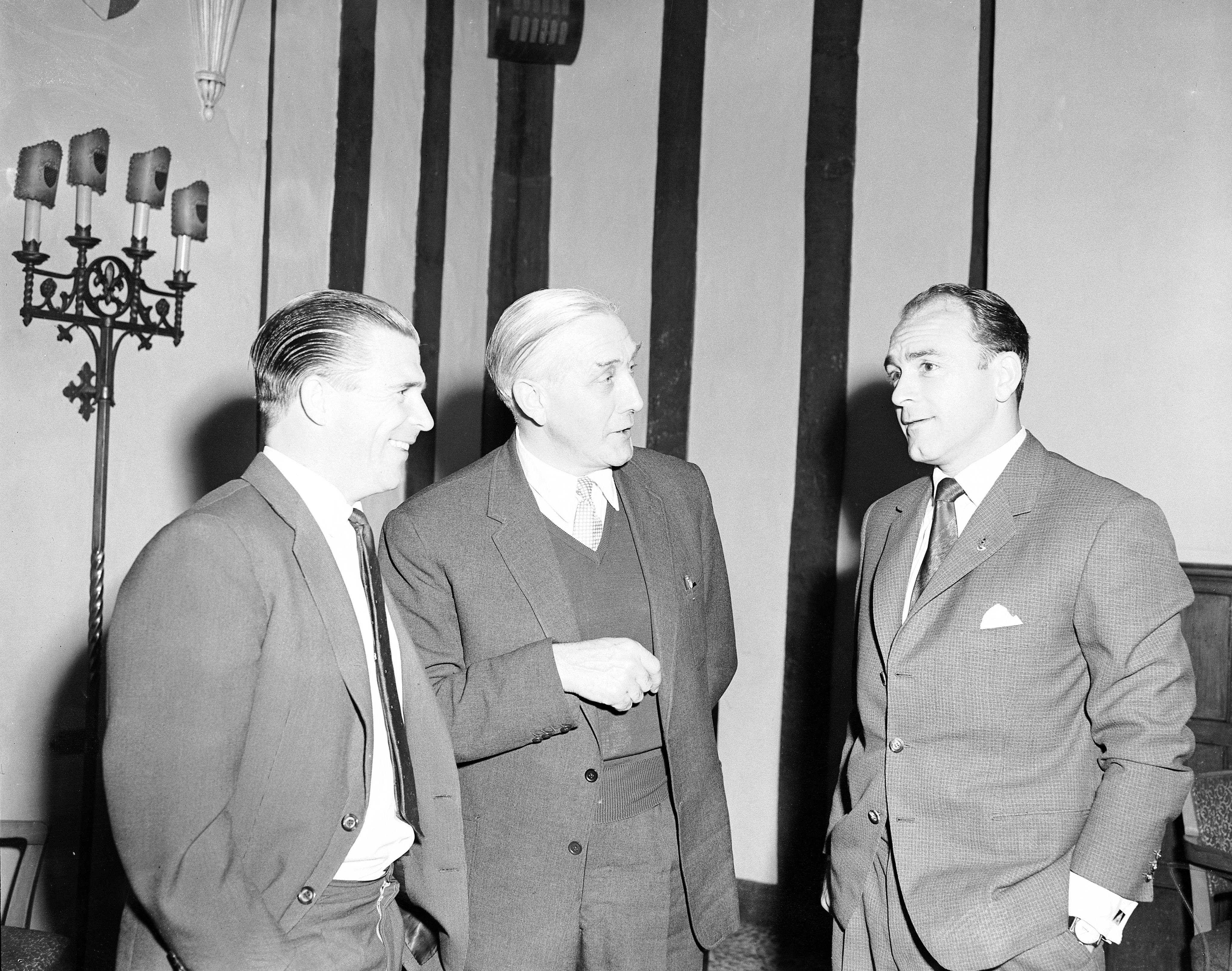 Soccer - Reception for Real Madrid Players at Park Lane Hotel Crystal Palace manager Arthur Rowe (c), whose team are to play Real Madrid in a friendly, chats with Madrid stars Ferenc Puskas (l) and Alfredo di Stefano (r) Date: 16/04/1962