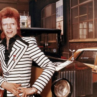 David Bowie Poses Beside His Rolls Royce In 1973