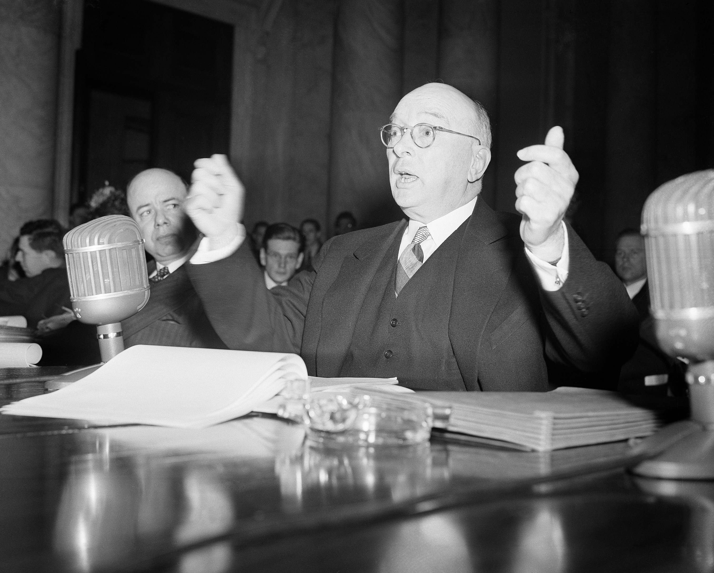 W. S. Farish, President of Standard Oil (New Jersey), hears charges from the senate defense investigating committee in Washington, March 31, 1942, that the company frustrated synthetic rubber development in the United States through agreements with a German firm. (AP Photo)