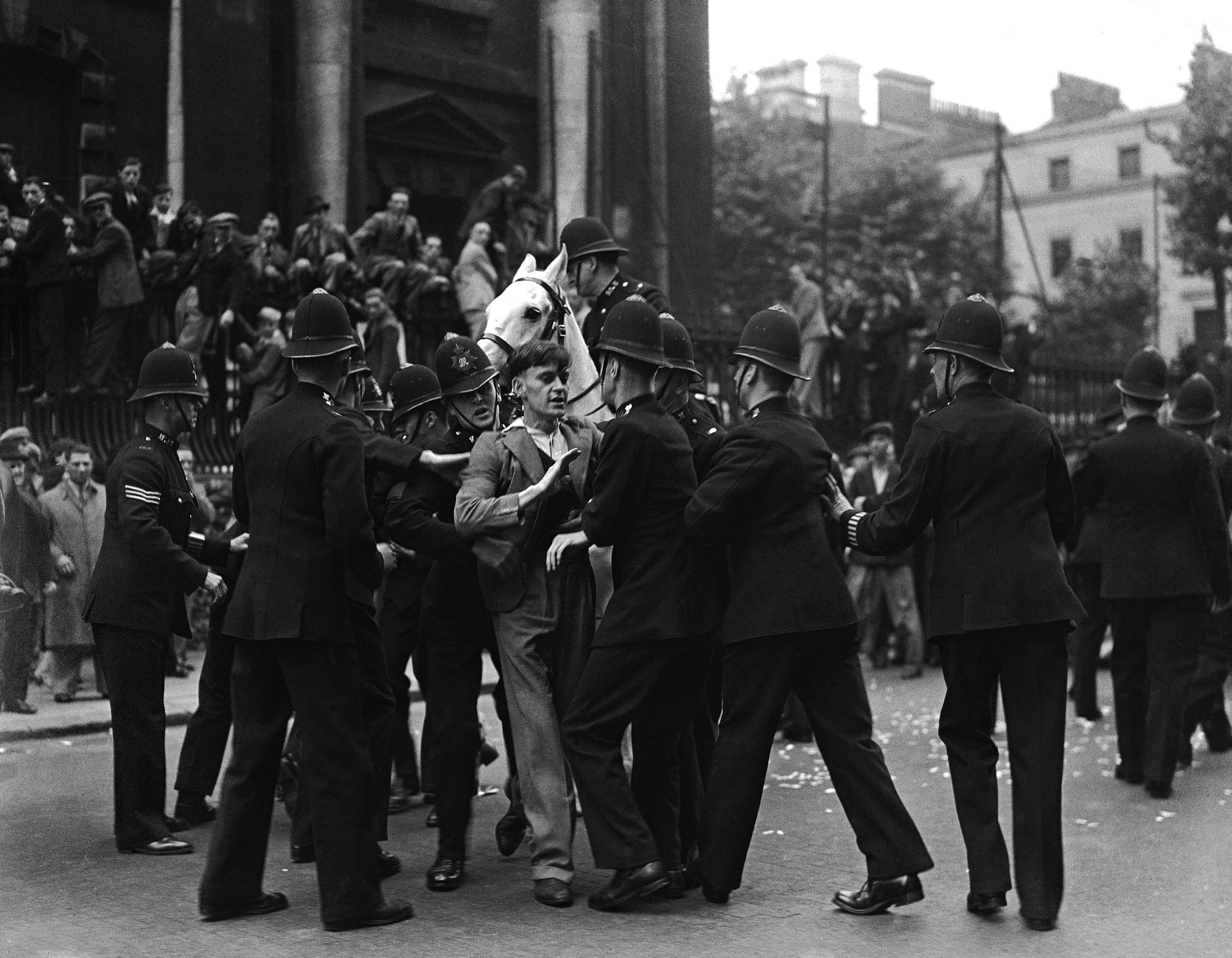 A young demonstrator struggling with police as the fascists from Kentish Town, led by Sir Oswald Mosley, marched into Trafalgar Square for their meeting on July 4, 1937.
