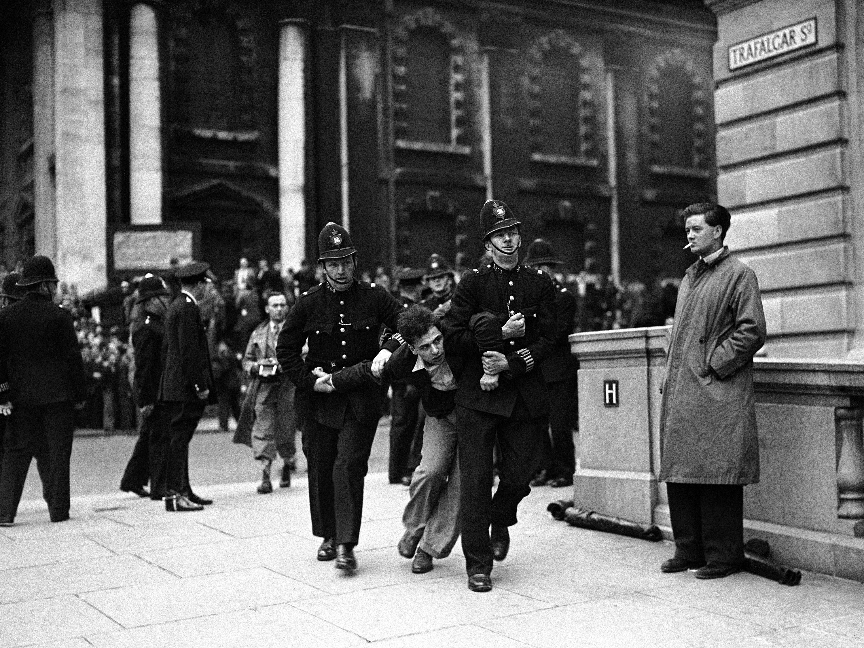demonstrator struggling with police as the fascists from Kentish Town, led by Sir Oswald Mosley, marched into Trafalgar Square for their meeting on July 4, 1937