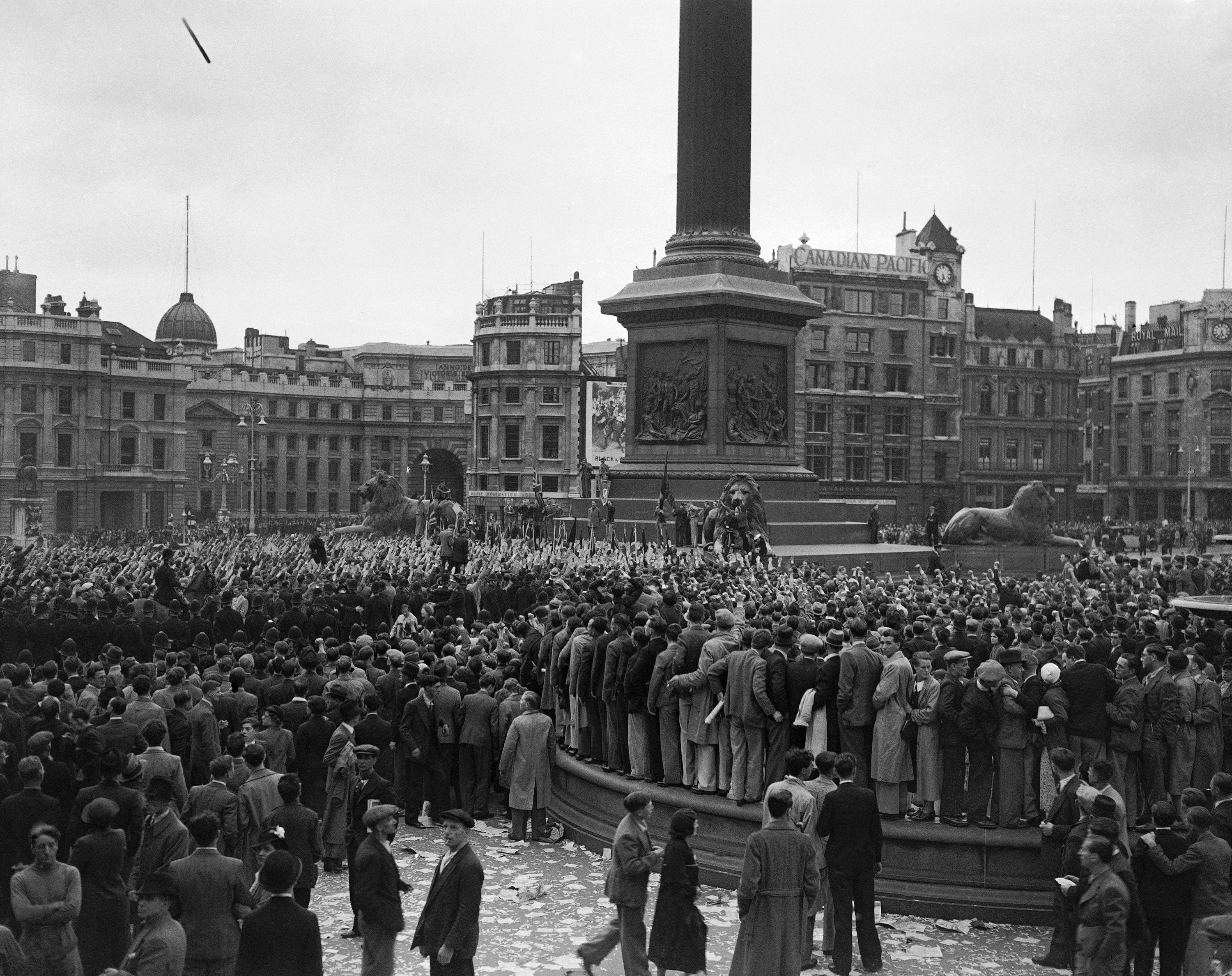 Sir Oswald Mosley's fascist marchers had arrives from Kentish town for their meeting in Trafalgar Square in London on July 4, 1937. On one side of the police cordon communists give the clenched fist salute, while on the other side the fascists' outstretched arms are seen.