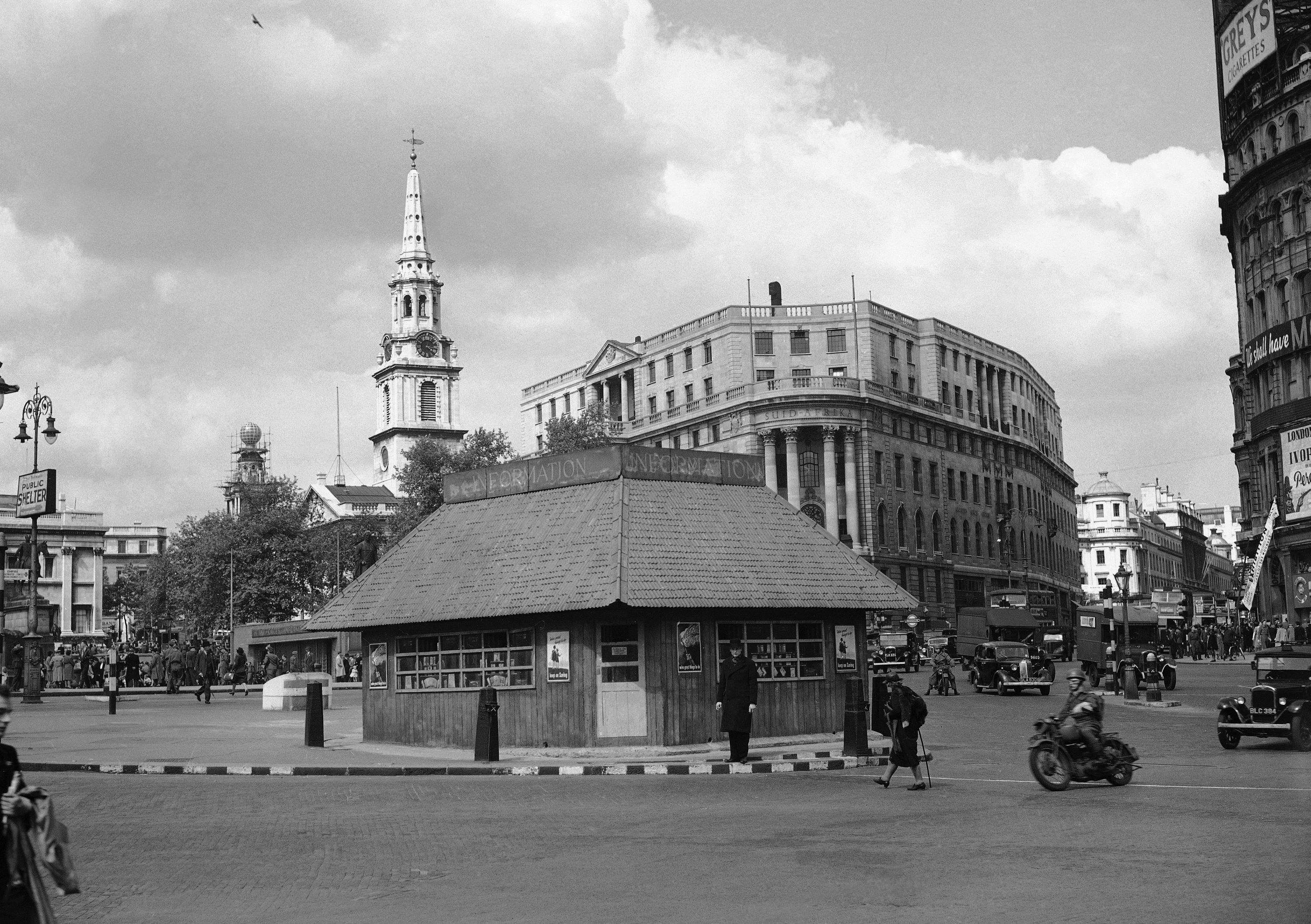 An Information bureau in Trafalgar Square  brought hundreds of visitors across the street to seek guidance which they did not get. It was one of the camouflaged concrete pillboxes to be used in case of invasion.