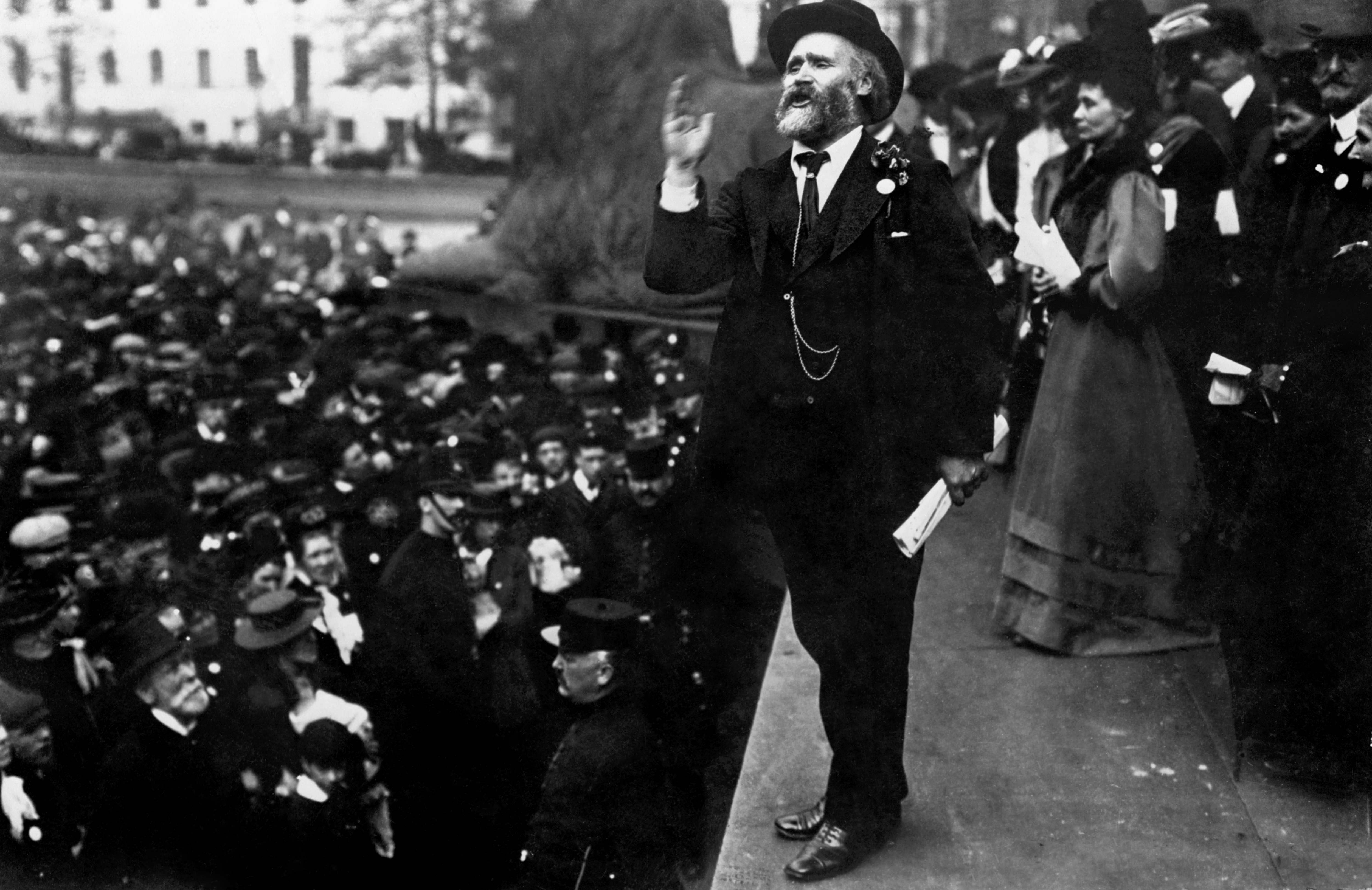 1908: Labour politician Keir Hardie speaking in Trafalgar Square at a Women's Suffrage demonstration. Just behind is the founder of the Women's Social and Political Union, Emmeline Pankhurst.