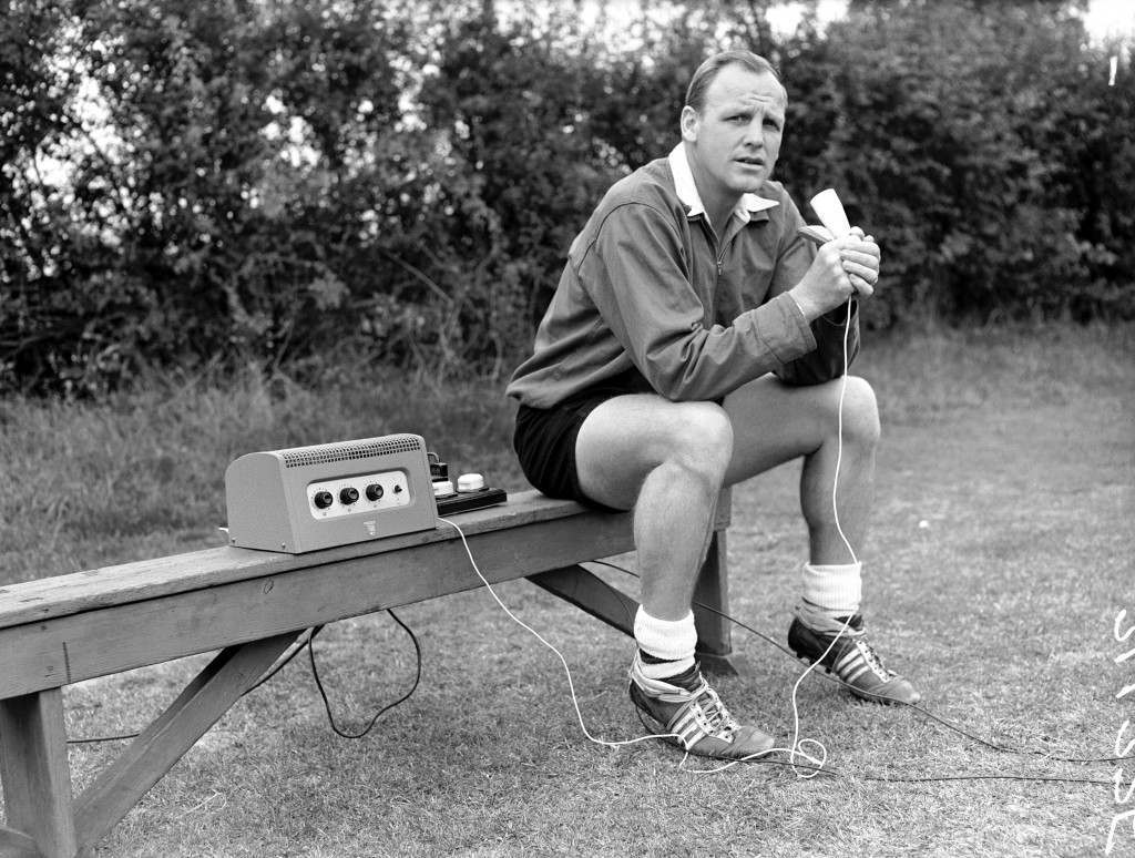Arsenal coach Ron Greenwood coaches his players by radio in the first demonstration of the system in Britain. The players wear a lightweight receiver and earpiece to enable them to hear Greenwood's promptings
