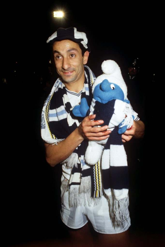 Ossie Ardiles celebrates with a toy smurf after Spurs win in the UEFA Cup against Anderlecht