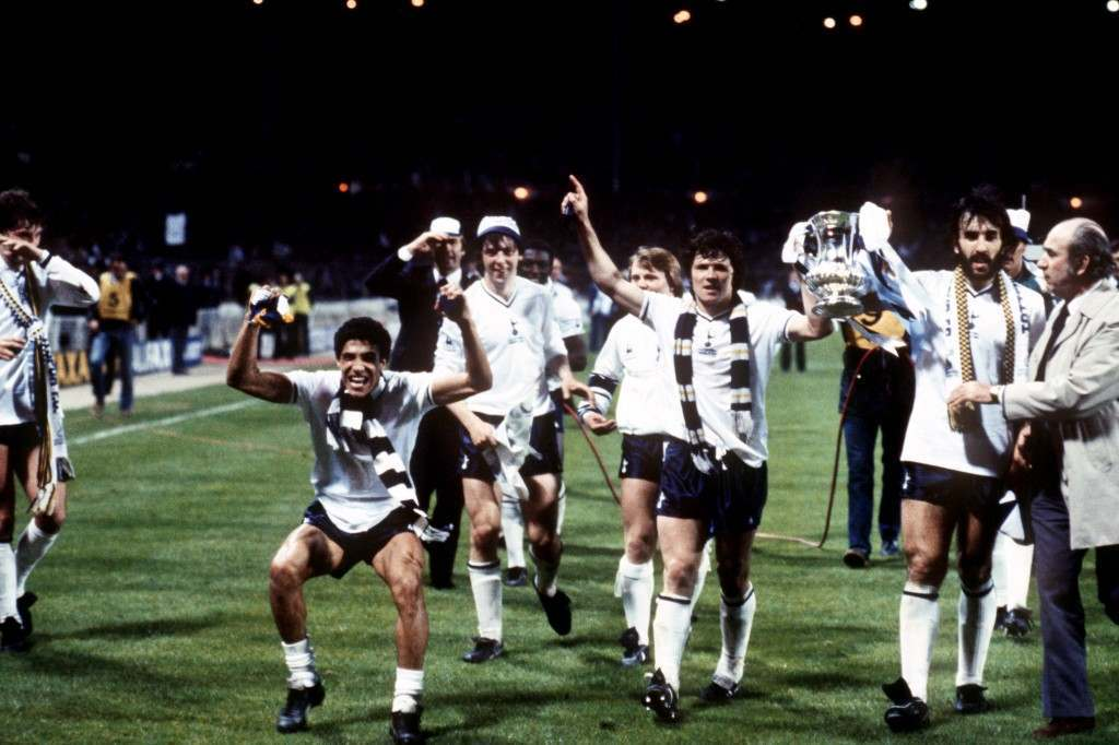 Tottenham Hotspur's Steve Perryman (second r) and Ricardo Villa (third r) parade the FA Cup as teammates Glenn Hoddle (l), Chris Hughton (second l), Tony Galvin (third l) and Gary Brooke (fourth l) celebrate victory