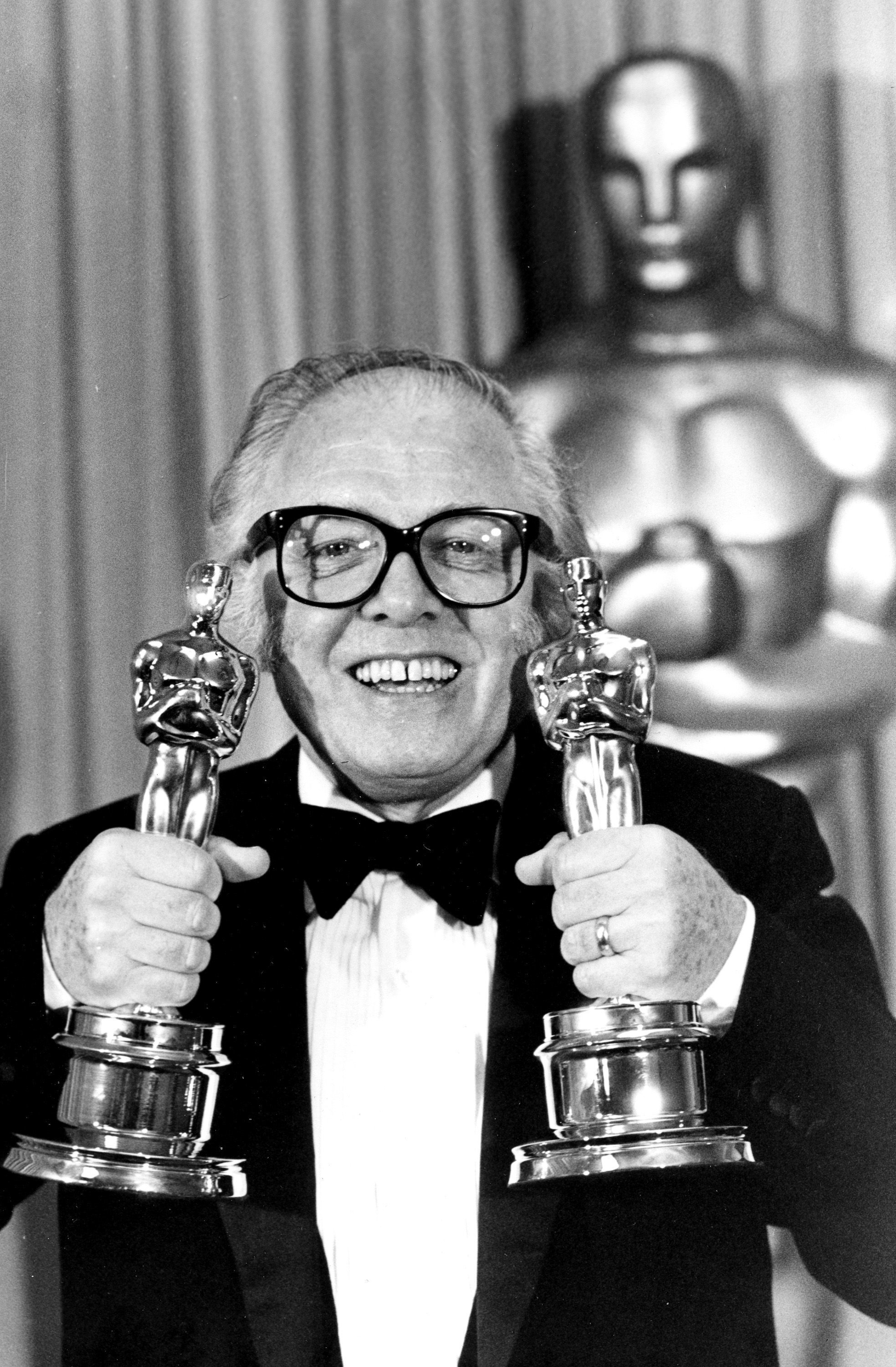 "Sir Richard Attenborough holds his two Oscars for his epic movie ""Gandhi"" at the 55th annual Academy Awards in Los Angeles, Ca., Monday, April 11, 1983. Attenborough won the best director and best picture awards. (AP Photo)"
