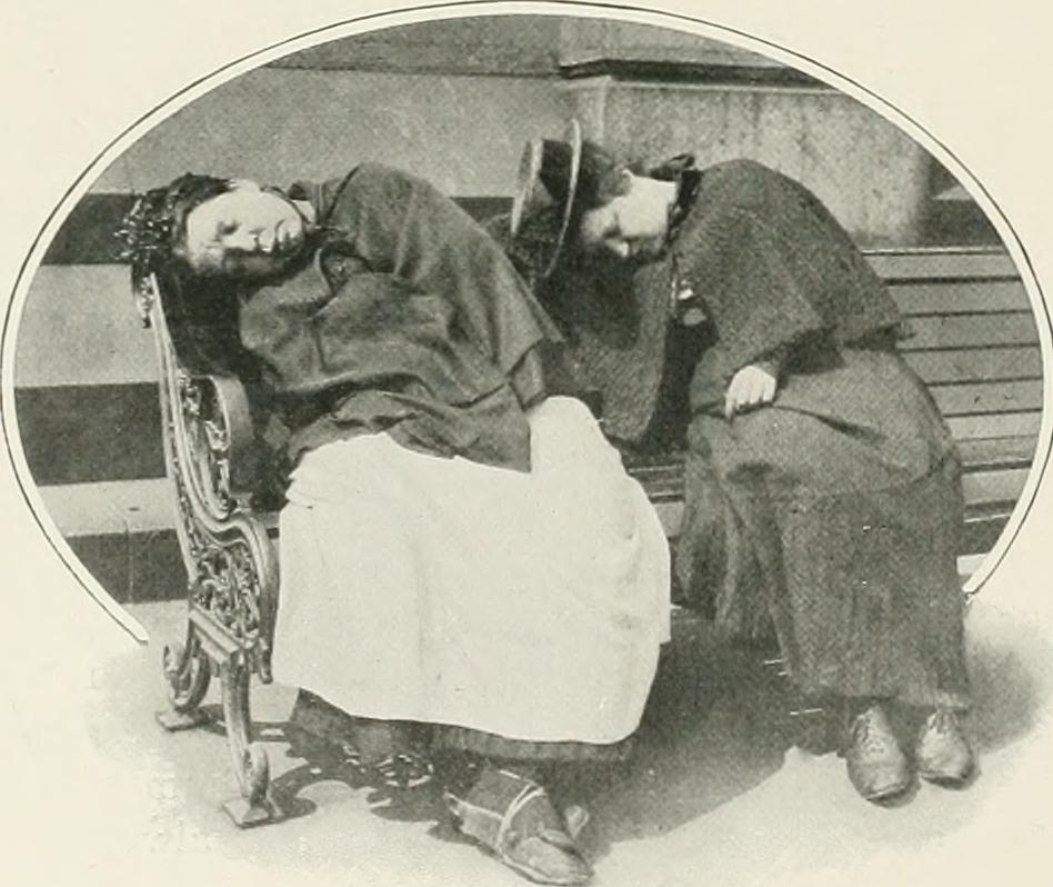 Two female 'tramps' sleeping in the sun at Trafalgar Square.