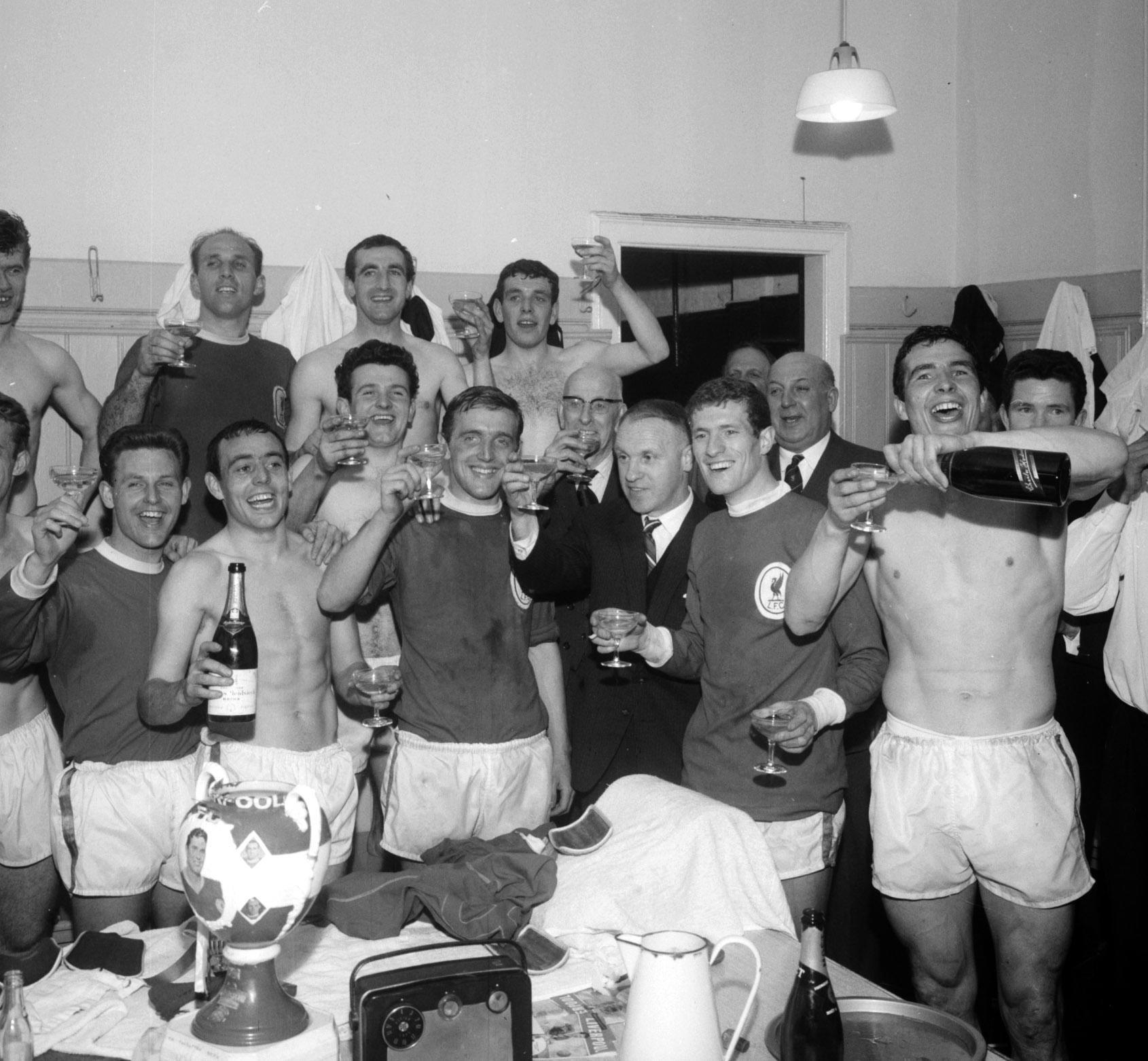 The Liverpool players and manager Bill Shankly (centre with suit) celebrating with champagne in the dressing room at Anfield, after the 5-0 victory over Arsenal which gave them the League Championship. 18/4/1964