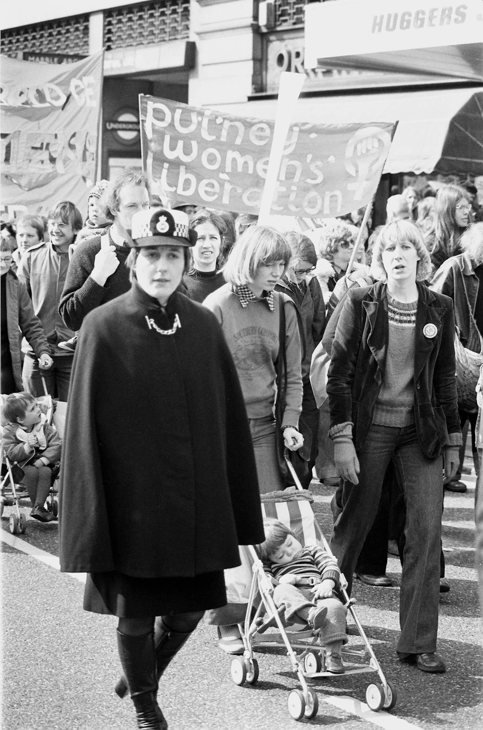 Caped police escort for supporters of the National Abortion  Campaign when they marched from Speaker's Corner to Trafalgar Square for a mass rally. 03/04/1976