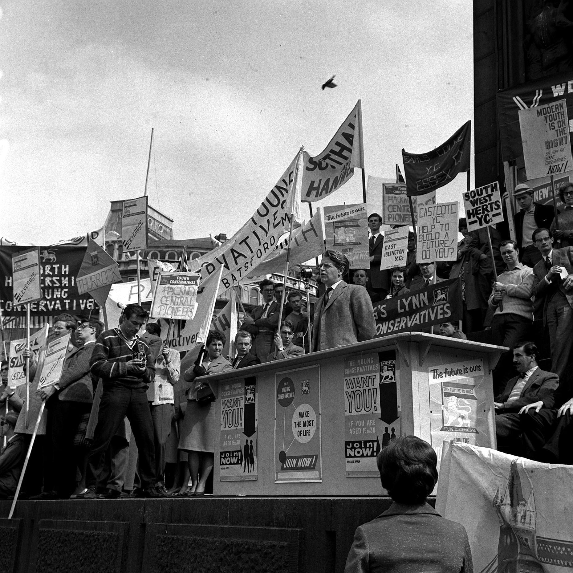 27th May, 1961: Surrounded by banners of every shape and size, Mr Christopher Chataway, Tory member of Parliament for North Lewisham, pictured when he spoke at a Young Conservatives rally in Trafalgar Square