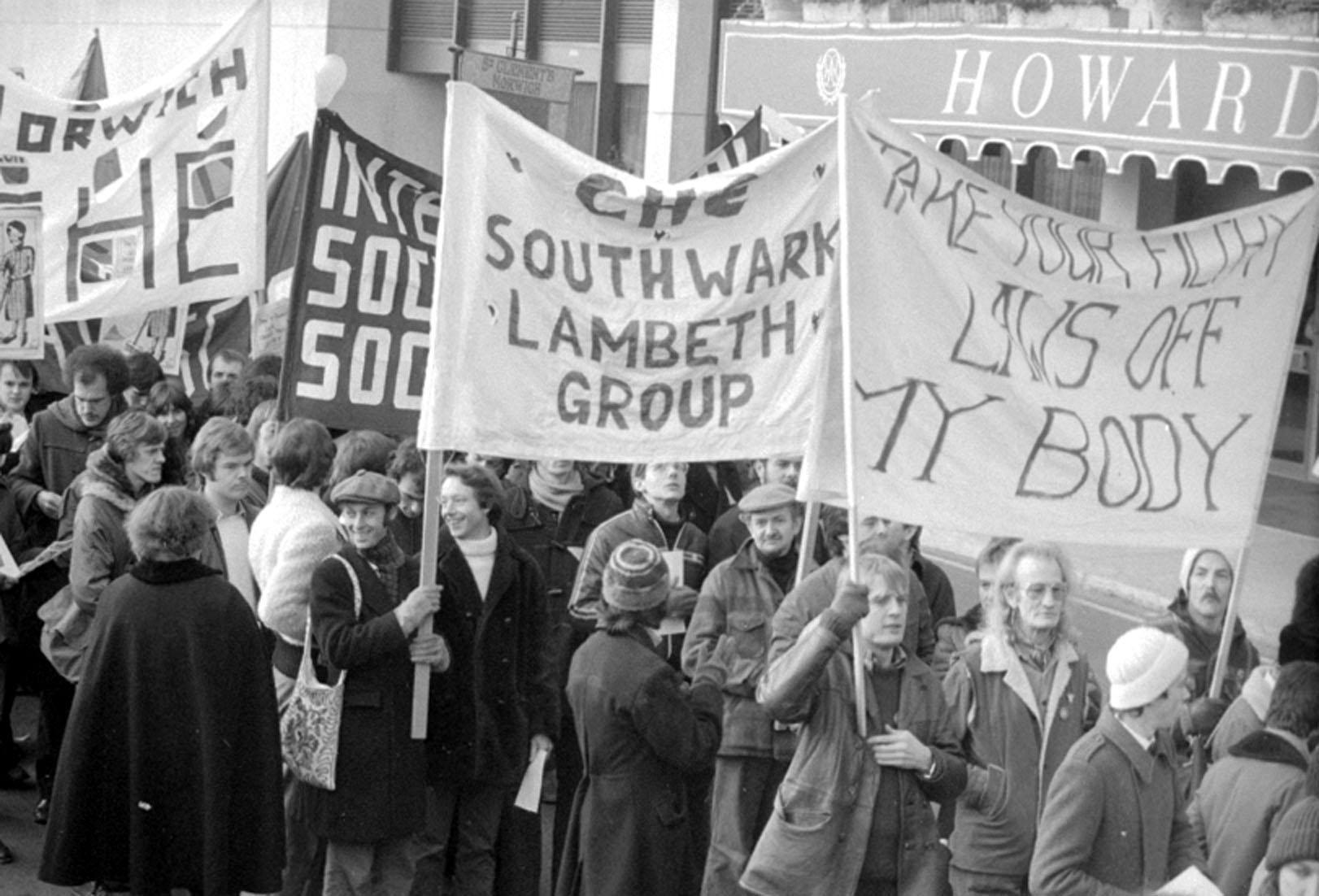 Demonstrators raise their banners as they leave the Embankment at Charing Cross on a march to Trafalgar Square for a rally organised by the National Gay News Defence Committee. 11/02/1978