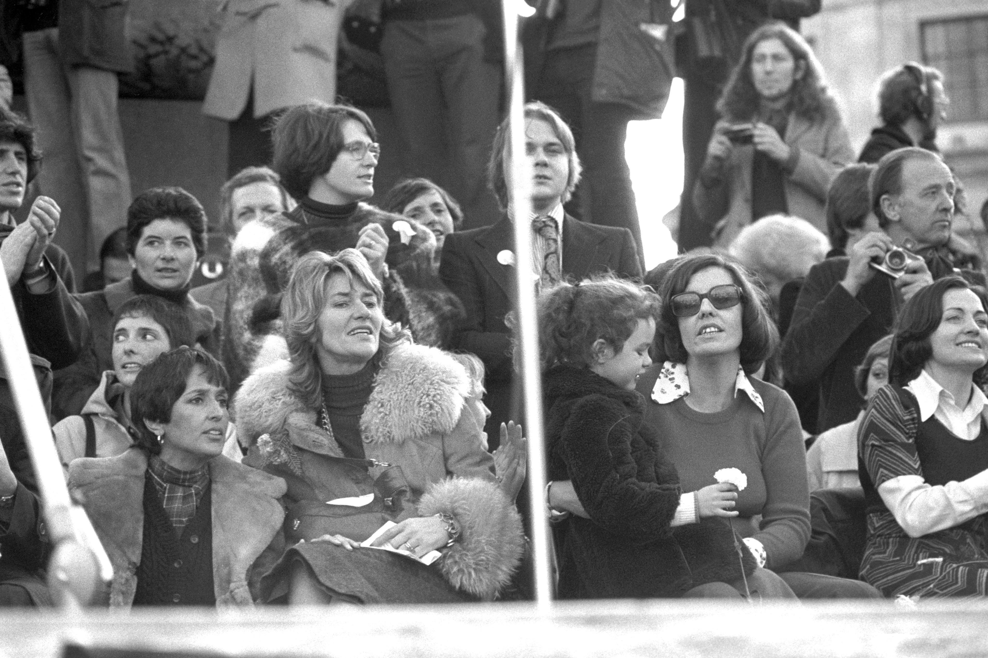 (From left) American folk singer Joan Baez, Jane Ewart-Biggs, widow of the murdered British Ambassador to Dublin Betty Williams wearing dark glasses and Mairead Corrigan on arrival to Trafalgar Square in London after the march of Ulster Peace People. 27th November 1976.