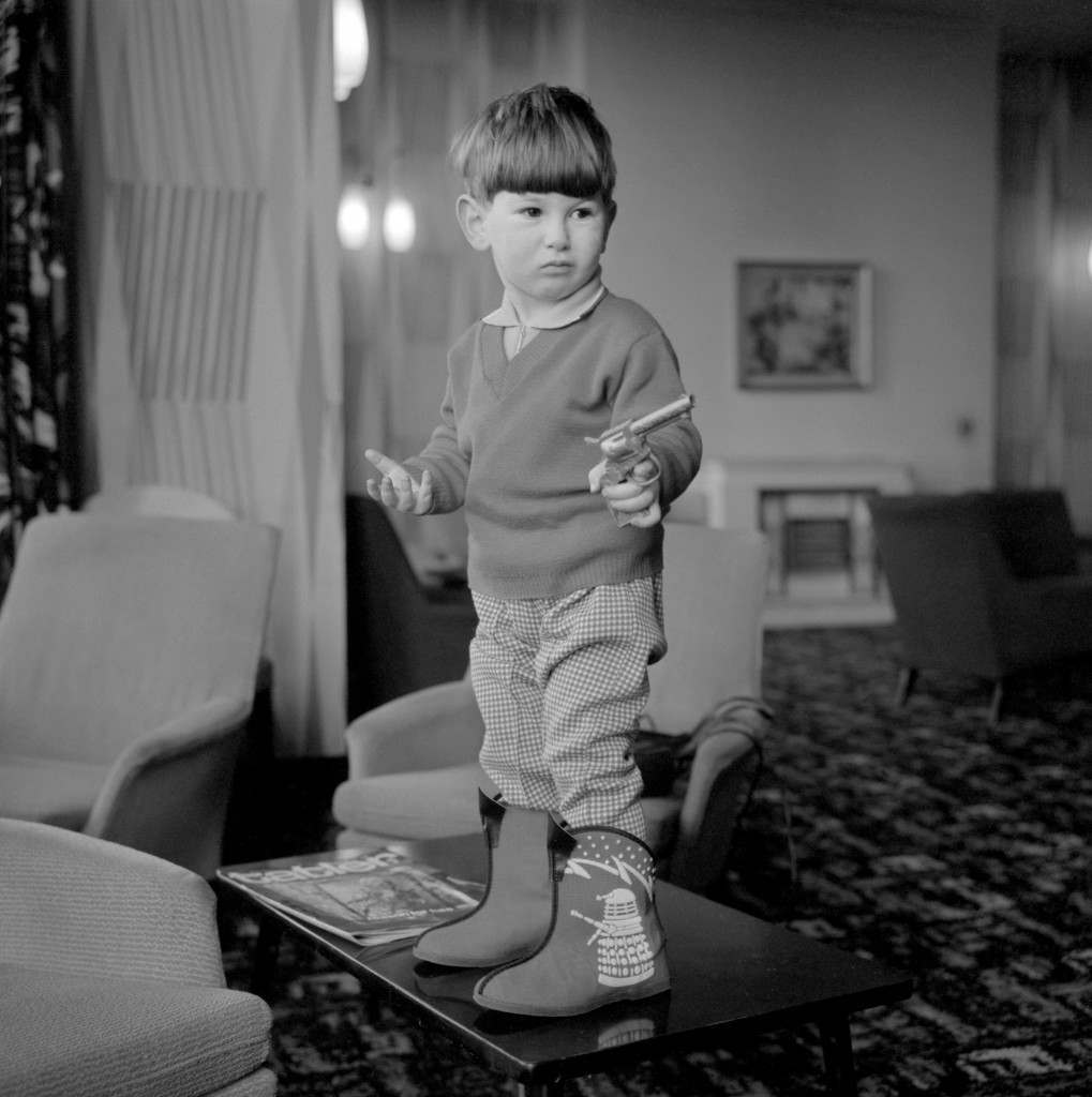 """Television - BBC TV -""""Dr Who"""" - Dalek Slippers 2 year old David Furman of Hull, whose father owns a shoe shop, wearing the latest thing in slippers - decorated with a Dalek motif, from the BBC television programme """"Dr Who"""". Ref #: PA.10285785 Date: 02/02/1965"""