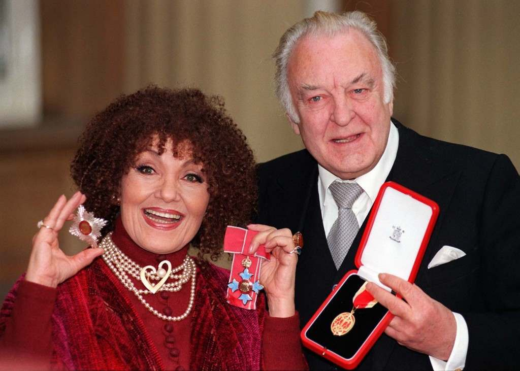Actor Sir Donald Sinden and jazz singer Dame Cleo Laine at Buckingham Palace today (Tuesday) where they received their investitures from the Queen. Photo by John Stillwell.  Date: 09/12/1997